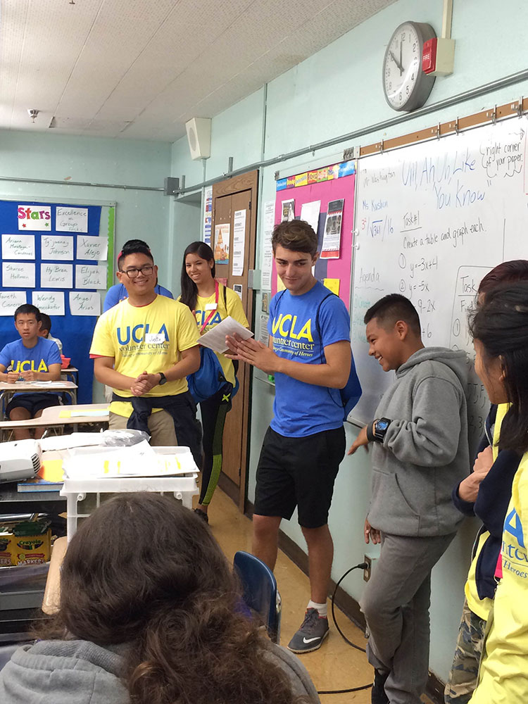 UCLA students lead activities in the classroom.